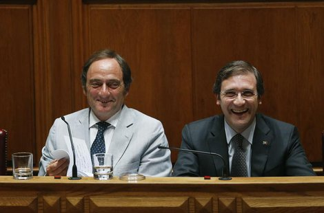 Portugal's Prime Minister Pedro Passos Coelho (R) and Deputy Prime Minister Paulo Portas smile during the debate to vote on a motion of conf