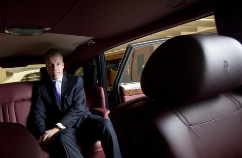 Torsten Mueller Oetvoes, chief executive officer of Rolls-Royce Motor Cars Ltd., poses for photos after an interview at a Rolls-Royce showro