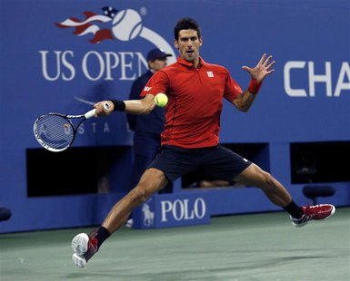 Novak Djokovic of Serbia hits a return to Rafael Nadal of Spain during their men's final match at the U.S. Open tennis championships in New