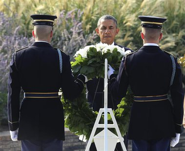 U.S. President Barack Obama lays a wreath before remembrance ceremonies for 9/11 victims at the Pentagon 9/11 Memorial in Washington Septemb