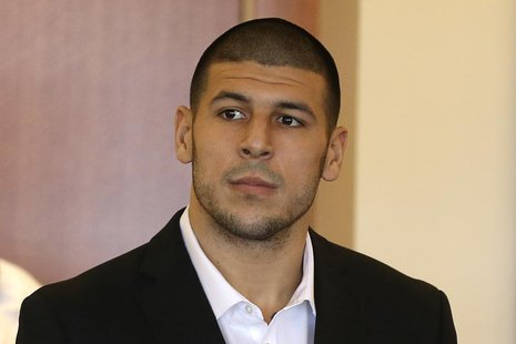 Aaron Hernandez, former player for the NFL's New England Patriots football team, stands during his arraignment in the Bristol County Superio