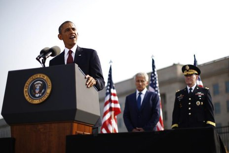 U.S. President Barack Obama speaks alongside Secretary of Defense Chuck Hagel (C) and Chairman of the Joint Chiefs of Staff Martin Dempsey (