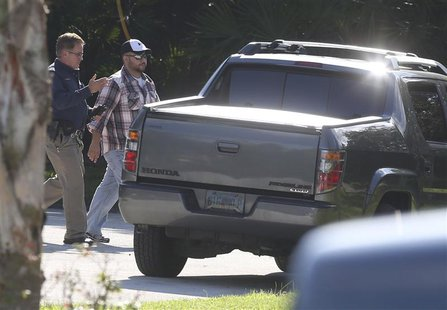 Geroge Zimmerman (R) walks toward his vehicle before entering a house that he and his wife Shellie Zimmerman were renting in Lake Mary, Flor