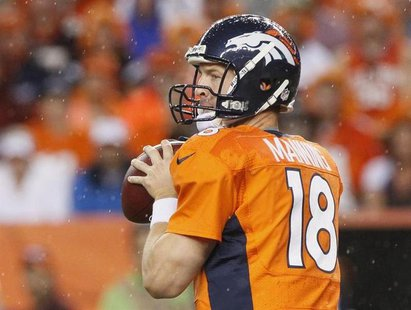 Denver Broncos quarterback Peyton Manning looks to pass against the Baltimore Ravens during their NFL football game in Denver, Colorado Sept