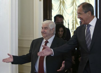 Russia's Foreign Minister Sergei Lavrov (R) shows the way to his Syrian counterpart Walid Moualem during a meeting in Moscow September 9, 20
