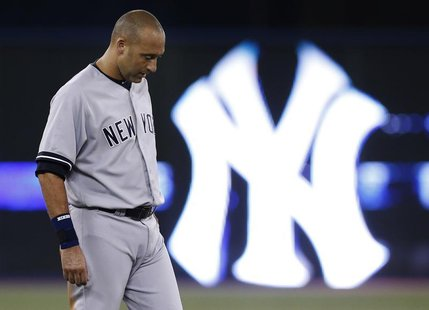 New York Yankees' Derek Jeter reacts after the end of the first inning against the Toronto Blue Jays in their MLB American League baseball g