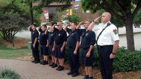 Green Bay Metro firefighters salute commemorating the 12th anniversary of the 9-11 terrorist attacks. (Photo by: WTAQ Reporter Jeff Flynt).