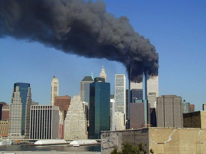 World Trade Center towers burning.  This image was originally posted to Flickr by Lil' Mike at http://flickr.com/photos/99829373@N00/239262070. It was reviewed on 14 October 2010 by the FlickreviewR robot and was confirmed to be licensed under the terms of the cc-by-2.0.