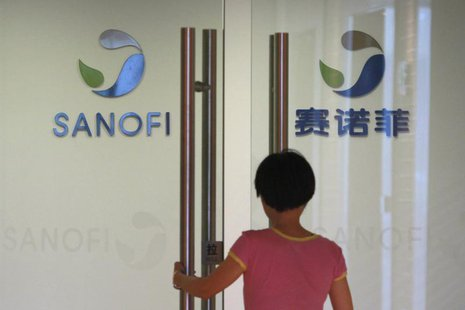 An employee walks into an office of French drugmaker Sanofi in Shanghai August 2, 2013. REUTERS/Aly Song