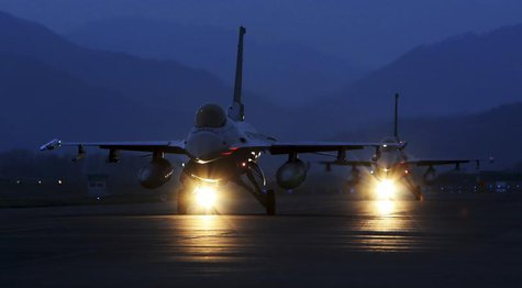 KF-16 fighter jets of the South Korean air force prepare to take off during a night flight operation at an air base in Chungju, about 100 km