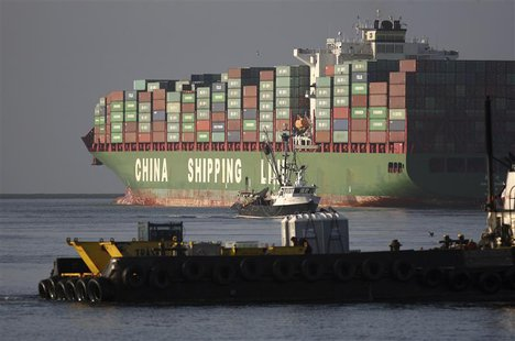 The Xin Mei Zhou container ship is seen at the Port of Los Angeles in Los Angeles, California, May 30, 2012. REUTERS/David McNew