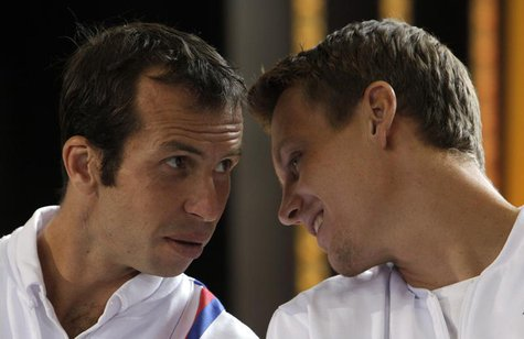 Czech Republic's Radek Stepanek (L) and Tomas Berdych chat during the draw for the Davis Cup semifinals in Prague September 12, 2013. REUTER