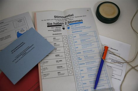"Voting papers for the upcoming German general elections are seen inside a ""mail-voting"" booth at the town hall of Hanau, 30km south of Frank"