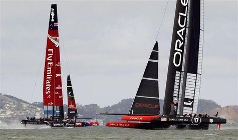 Emirates Team New Zealand (L) takes a lead against Oracle Team USA during Race 5 of the 34th America's Cup yacht sailing race in San Francis