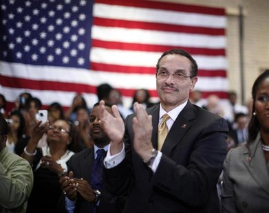 Washington Mayor Vincent Gray applauds U.S. President Barack Obama as he delivers his third annual back-to-school speech at Benjamin Banneke