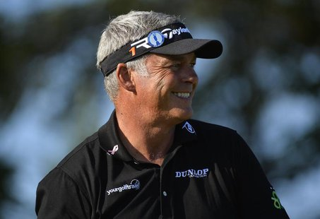 Darren Clarke of Northern Ireland smiles as he stands on the second tee during the second round of the British Open golf Championship at Mui