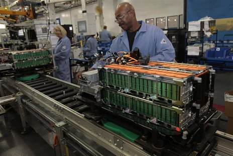 Ford Motor production workers assemble batteries for Ford electric and hybrid vehicles at the Ford Rawsonville Assembly Plant in Ypsilanti T