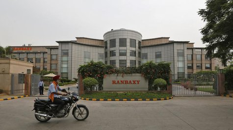 A man rides a motorcycle in front of the office of Ranbaxy Laboratories at Gurgaon, on the outskirts of New Delhi, June 13, 2013. REUTERS/Ad