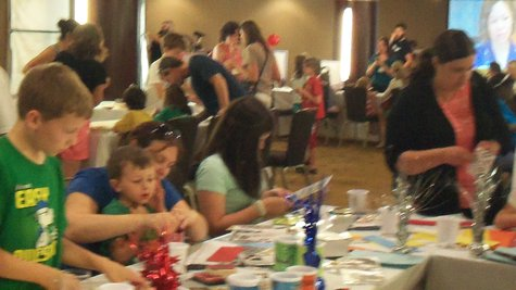Parents and children working together to create gifts and projects for local non-profits.