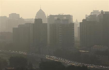 Vehicles past apartment blocks during rush hour in Beijing July 11, 2013. Credit: Reuters/Jason Lee
