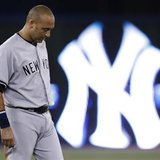 New York Yankees' Derek Jeter reacts after the end of the first inning against the Toronto Blue Jays in their MLB American League baseball game in Toronto August 28, 2013. Credit: Reuters/Mark Blinch