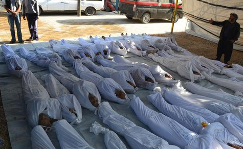 ATTENTION EDITORS - VISUALS COVERAGE OF SCENES OF DEATH AND INJURY Syrian activists inspect the bodies of people they say were killed by ner
