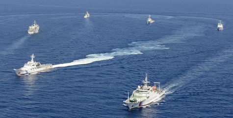 Vessels from the China Maritime Surveillance and the Japan Coast Guard are seen near disputed islands, called Senkaku in Japan and Diaoyu in