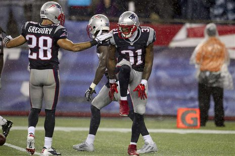 New England Patriots Aqib Talib (31) celebrates with Steve Gregory his first interception against the New York Jets during their NFL AFC Eas