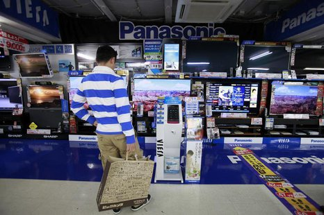 A man looks at Panasonic Corp's Viera TVs displayed at an electronics store in Tokyo October 28, 2012. REUTERS/Yuriko Nakao