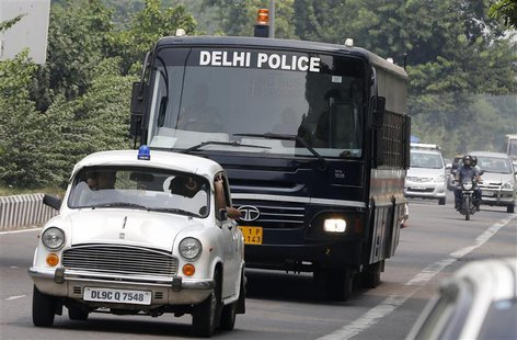 A police bus carrying four men who were found guilty of the fatal gang-rape of a young woman on a bus, arrives at a court in New Delhi Septe
