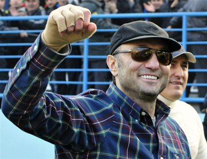 Dagestani born tycoon Suleiman Kerimov watches a soccer match between Anzhi and CSKA in Makhachkala December 2, 2012. REUTERS/Sergei Rasulov