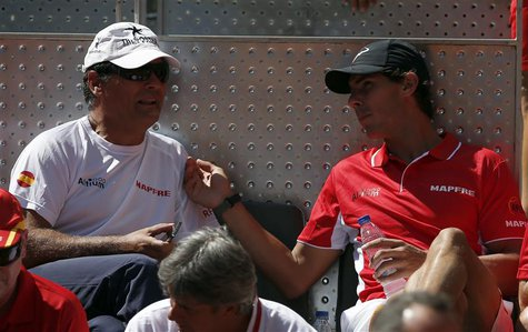 Spain's Rafael Nadal (R) chats with his uncle and coach Toni Nadal at the start of Davis Cup World Group playoff tennis tie between Spain's