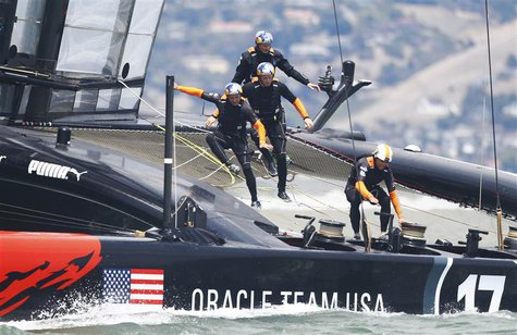 Oracle Team USA team trains on their AC72 catamaran on San Francisco Bay, California in this August 6, 2013 file photo. REUTERS/Peter Andrew