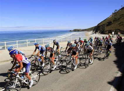 Cyclists ride near the sea during the 181-km 19th stage of the Vuelta, Tour of Spain cycling race from San Vicente de la Barquera to Alto de