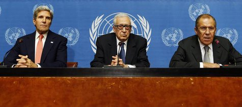 U.S. Secretary of State John Kerry (L) sits with U.N. Special Representative Lakhdar Brahimi (C) and Russian Foreign Minister Sergei Lavrov