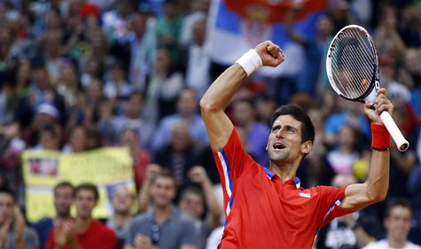 Serbia's Novak Djokovic celebrates his victory over Canada's Vasek Pospisil after their Davis Cup semi-final tennis match in Belgrade Septem