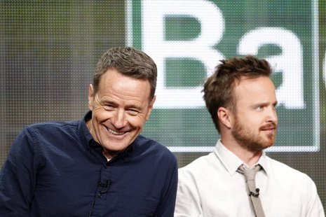 "Cast member Bryan Cranston (L) smiles next to co-star Aaron Paul at a panel for the television series ""Breaking Bad"" during the AMC portion"