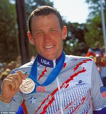 Lance Armstrong posing with his bronze medal he won at the Summer Olympic Games held in Sydney, Australia in 2000.