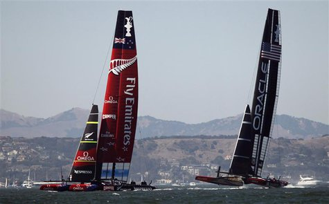 Emirates Team New Zealand (L) takes the early lead against Oracle Team USA during Race 1 of the 34th America's Cup yacht sailing race in San