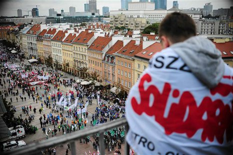 A protester from the Solidarity trade union looks down as people gather for an anti-government protest in central Warsaw September 14, 2013.