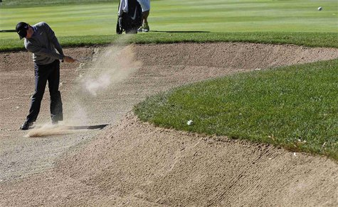 Rory McIlroy of Northern Ireland hits out of the sand trap the first hole during the second round of the BMW Championship golf tournament at