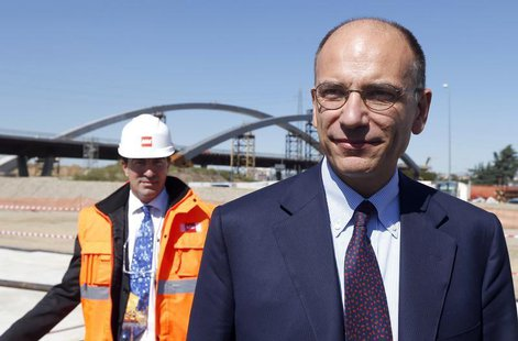 Italian Prime Minister Enrico Letta arrives at the construction site of Expo 2015, on the outskirts of Milan, September 13, 2013. REUTERS/ S
