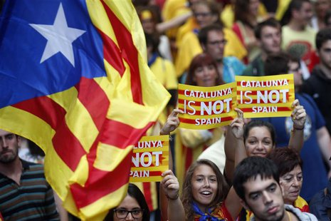 "Separatist protesters hold up placards as they demonstrate during ""Diada de Catalunya"" (Catalunya's National Day) in central Barcelona, Sept"