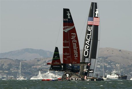 Emirates Team New Zealand (L) sails on one hull against Oracle Team USA during Race 8 of the 34th America's Cup yacht sailing race in San Fr
