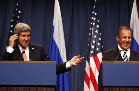 U.S. Secretary of State John Kerry (L) gestures next to Russian Foreign Minister Sergei Lavrov as they make statements following meetings re