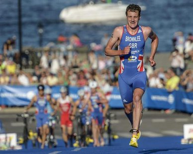 Britain's Alistair Brownlee runs on his way to winning the ITU World Triathlon elite race for men in Stockholm City August 25, 2013. REUTERS