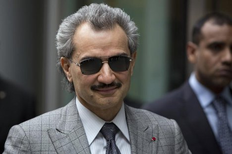 Prince Alwaleed bin Talal is seen leaving the High Court in London in this July 2, 2013 file photograph. REUTERS/Neil Hall/Files