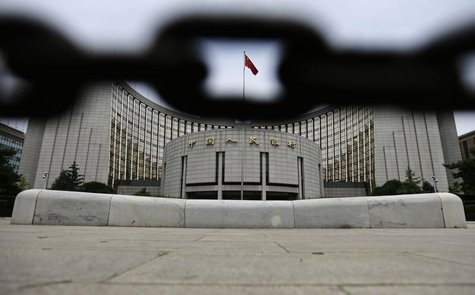 The headquarters of China's central bank, the People's Bank of China, is pictured behind an iron chain in Beijing, June 21, 2013. REUTERS/Ja