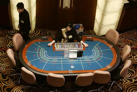 A high angle view of croupiers preparing to greet visitors at Sands Macau casino in Macau, a former Portuguese enclave before reverting to C