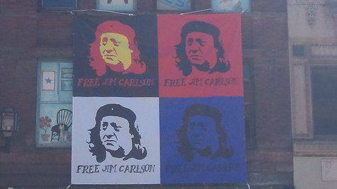 Free Jim Carlson sign above Last Place On Earth